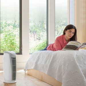 girl in a room with air cleaner